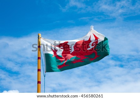 Welsh flag showing the red dragon of Wales flying in the summer sun.