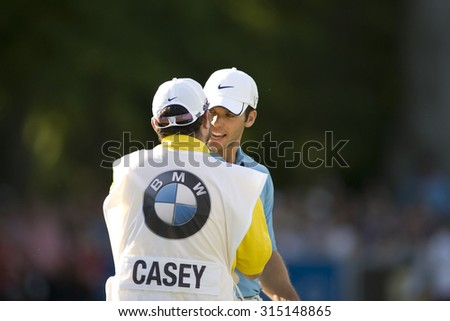 WENTWORTH, ENGLAND. 24 MAY 2009.Paul Casey and his caddy after winning the European Tour BMW PGA Championship. - stock photo