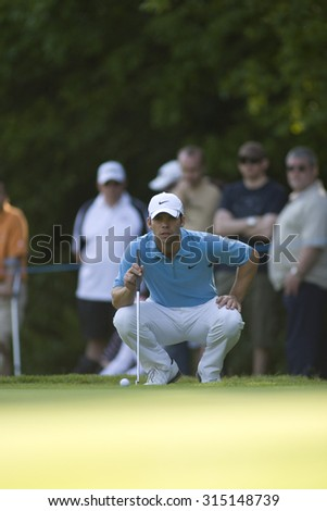 WENTWORTH, ENGLAND. 24 MAY 2009.Paul Casey lines up a putt on his way to winning the European Tour BMW PGA Championship. - stock photo
