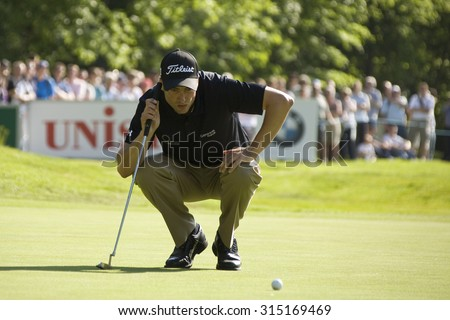WENTWORTH, ENGLAND. 24 MAY 2009.Ross Fisher (GBR) lines up a putt playing in the final round of the European Tour BMW PGA Championship. - stock photo