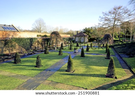 WENTWORTH, UK - FEBRUARY 8 2015: The historic gardens of Wentworth Woodhouse is set within the extensive former kitchen gardens and features the formal Italian Garden and canal pond - stock photo