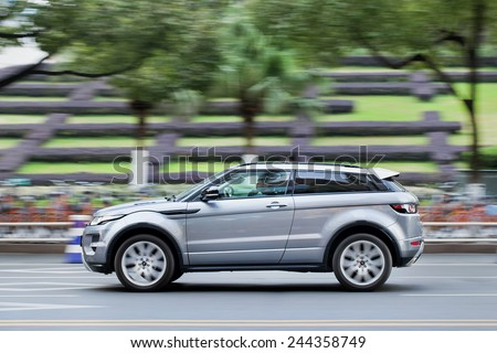 WENZHOU-CHINA-NOV. 19, 2014. Range Rover Evoque SUV downtown. Land Rover plans to complain to Chinese officials about (Landwind) copy of its Evoque SUV that recently appeared at Guangzhou Motor Show.  - stock photo
