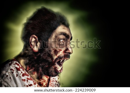 werewolf screaming and covered with blood - stock photo