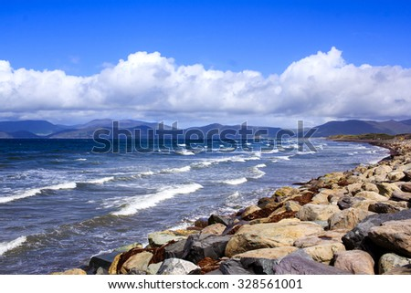 West coast of Ireland - beautiful rocky beach and waves in action above cloudy sky. - stock photo