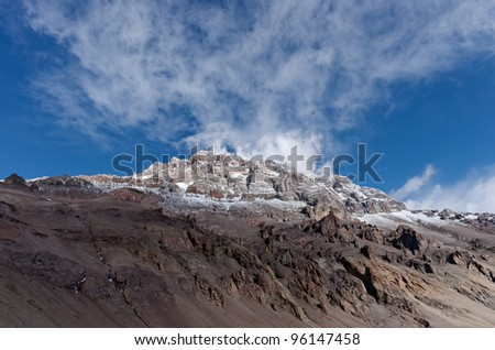 West face of Aconcagua. View from Plaza de Mulas base camp on Aconcagua Provincial Park, Mendoza, Argentina, South America. Aconcagua is the highest mountain in America. - stock photo