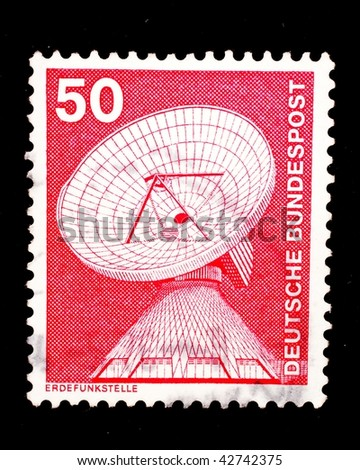 WEST GERMANY - CIRCA 1975: A stamp printed in West Germany shows image of an earth station (erdfunkstelle), used for receiving signals from spacecraft, circa 1975