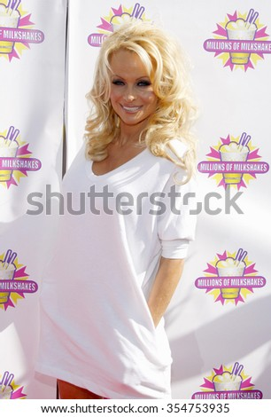 WEST HOLLYWOOD, CALIFORNIA - April 9, 2010. Pamela Anderson and PETA create the First ALL-VEGAN Shake held at the Millions of Milkshakes, West Hollywood.   - stock photo
