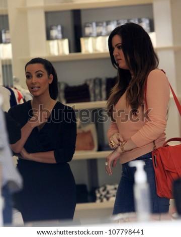 WEST HOLLYWOOD - JUL 13: Kim Kardashian, Khloe Kardashian at the opening of the new Dash store on July 13, 2012 in West Hollywood, California - stock photo