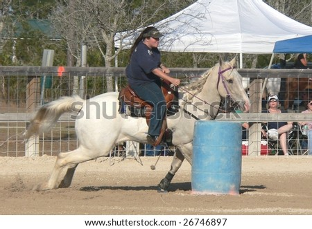 WEST PALM BEACH, FLORIDA - MARCH 14: An unidentified rider in action at the Palm Beach Mounted Posse Barrel Point show on March 14, 2009 in West Palm Beach, Florida.