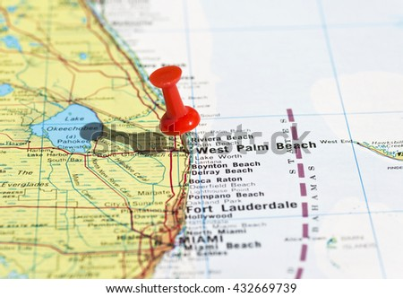 West Palm Beach marked on map with red pushpin. Selective focus on the word West Palm Beach and the pushpin. Pin is in an angle and casts some shadow to the left.  - stock photo