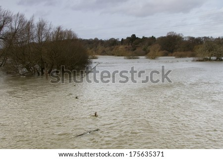 WEST PARLEY, DORSET, UK. 8th FEBRUARY 2014. Serious flooding of the River Stour in Southern England after prolonged storms. - stock photo