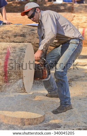 West Point, CA - October 4, 2014 Axe throwing & Chainsaw log cutting competitions at the Lumberjack Day Parade event - stock photo