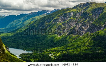 West side of the Lake Bohinj (Bohinjsko jezero) surrounded with the Julian Alps, Slovenia. - stock photo