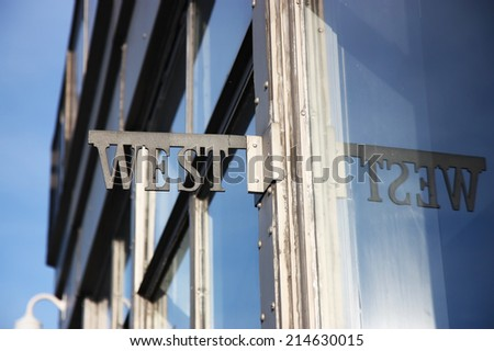 West signage on a building - stock photo