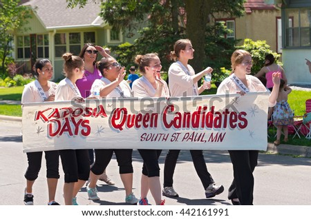 WEST ST. PAUL, MINNESOTA - MAY 21, 2016: Queen candidates for Miss South Saint Paul of Kaposia Days annual festival march at Grande Day Parade in West St. Paul on May 21.  - stock photo