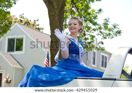 WEST ST. PAUL, MINNESOTA - MAY 21, 2016: West St. Paul Princess Samantha Thell waves to crowd during West St. Paul Days Grande Parade on May 21.  - stock photo