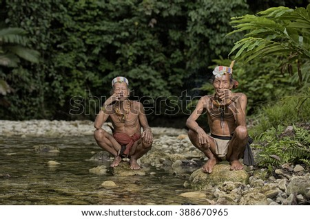 West Sumatera, Indonesia-June 16,2014: Unidentified old men of Mentawai.The indigenous inhabitants ethnic of the islands in Muara Siberut are also known as the Mentawai people.  - stock photo