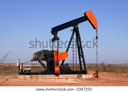 West Texas oil well pump showing walking beam horse head and polished rod - stock photo
