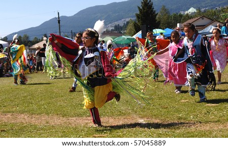 WEST VANCOUVER, BC, CANADA - JULY 10: Native Indian girls dance during annual Squamish Nation Pow Wow on July 10, 2010 in West Vancouver, BC, Canada - stock photo