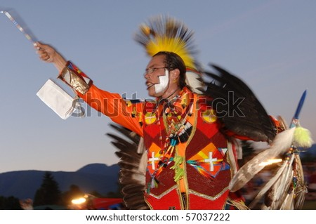 WEST VANCOUVER, BC, CANADA - JULY 10: Native Indian man dances during annual Squamish Nation Pow Wow on July 10, 2010 in West Vancouver, BC, Canada - stock photo