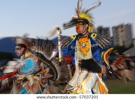 WEST VANCOUVER, BC, CANADA - JULY 10: Native Indian men dance during annual Squamish Nation Pow Wow on July 10, 2010 in West Vancouver, BC, Canada