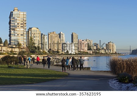 WEST VANCOUVER - JAN. 1, 2016: Where the popular Metro Vancouver's district West Vancouver touches the Pacific Ocean and close to Bellevue Ave is a popular promenade for walking, named Dundarave Beach - stock photo