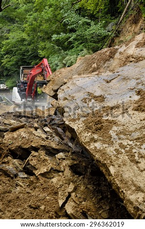 West Virginia Department of Highways workers seek to open highway closed by flashflood caused landslide along Birch River Road, Route 82 in Nicholas County, West Virginia, USA on July 13, 2015
