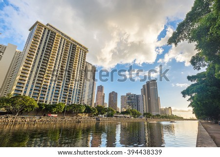 West Waikiki skyline along the Ala Wai Canal and the Hawaii Convention Center - stock photo
