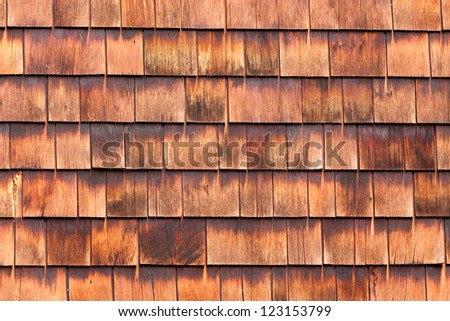 Westen red cedar shingles background texture pattern makes a natural organic wooden wall siding for residential buildings