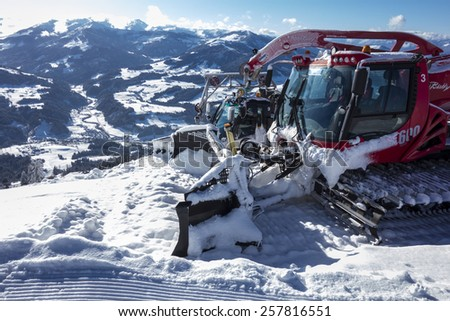 WESTENDORF, AUSTRIA - Januari 25 2015: Piste machine, Piste Bully in front of a winter landscape on 25 of January, Westendorf, Austria