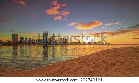 Western Australia - Golden Sunrise View of Perth Skyline from Swan River - stock photo