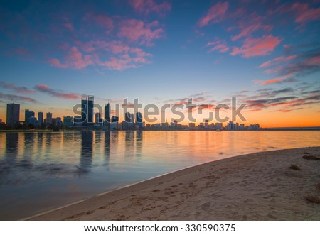 Western Australia - Vibrant Colors Sunrise View of Perth Skyline from Swan River - stock photo