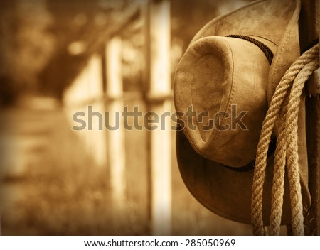 Western background with cowboy hat and lasso  - stock photo