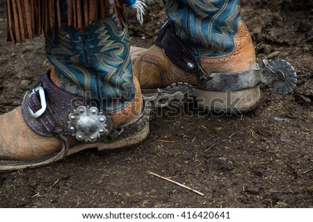 Western cowboy boots and silver spurs - stock photo