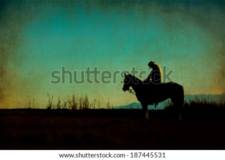 Western cowboy silhouette with texture at sunset and slivers of light - stock photo