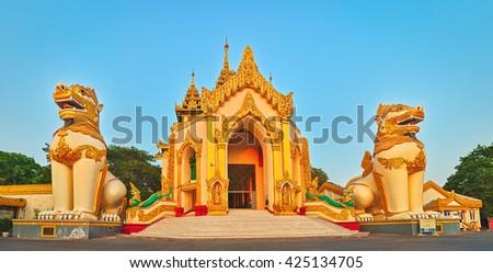 Western entrance of Shwedagon complex in Yangon. Myanmar. Panorama - stock photo