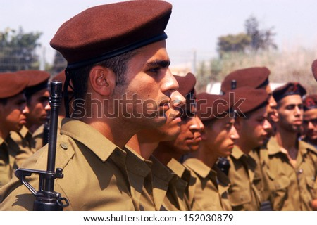 WESTERN NEGEV, ISRAEL - JULY 7: Israeli soldiers on July 7 2006. IDF is one of Israeli society's most prominent institutions, influencing the country's economy, culture and political scene. - stock photo