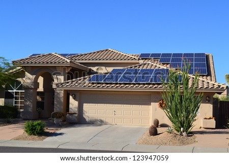 Western Ranch Style House with Solar Panels - stock photo