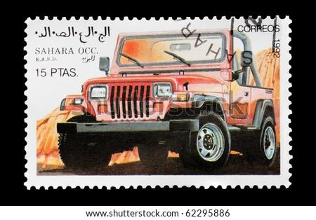 WESTERN SAHARA - CIRCA 1992: mail stamp printed in Western Sahara featuring an off-road 4x4 vehicle, circa 1992 - stock photo