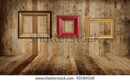 Western saloon floor and wall with empty picture frames. - stock photo