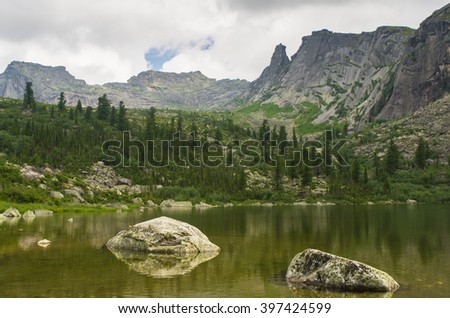 Western Sayan mountains, blue sky, natural Park Ergaki, rocks, lakes, rocks, fog, hills, tourism, vacation, beautiful expanses of Siberia, the test of strength of spirit, sunlight, clouds, forest - stock photo