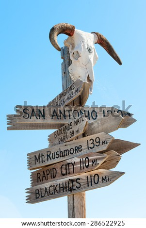 Western signpost with goat skull to famous US landmarks - stock photo