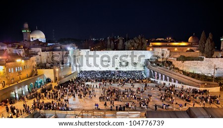 Western Wall  on the Temple Mount (Har Ha-Bayit) and the golden Dome of the Rock at night  in Jerusalem, Israel - stock photo