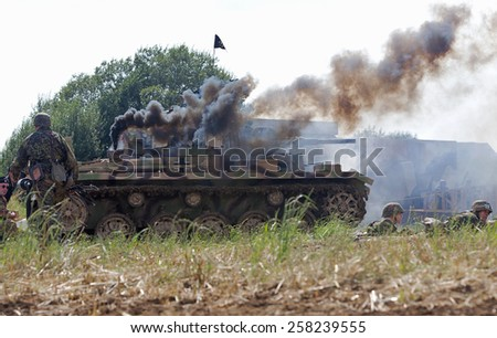 WESTERNHANGER, UK - JULY 19: A German panzer tank is set ablaze by allied fire during a WW2 battle re-enactment at the W&P show on July 19, 2014 in Westernhanger - stock photo
