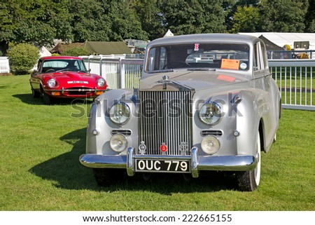 WESTERNHANGER, UK - JULY 17: A vintage Rolls Royce Silver Dawn automobile is displayed in the vintage motorcar section at the War & Peace show on July 17, 2014 in Westernhanger - stock photo