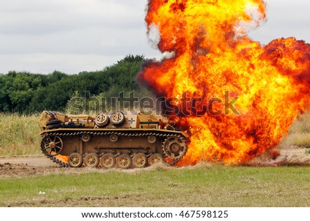 WESTERNHANGER, UK - JULY 21: An ex German army Panzer Stug has a pyro set off beneath the hull as part of the public entertainment at the War & Peace Revival show on July 21, 2016 in Westernhanger