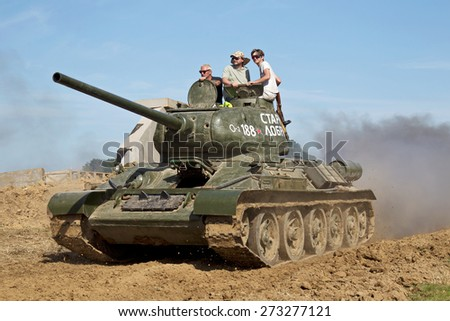 WESTERNHANGER, UK - JULY 18: An ex Russian army WW2 T34 main battle tank is driven around the main arena for the public to watch at the W&P show on July 18, 2014 in Westernhanger - stock photo