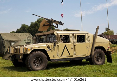 WESTERNHANGER, UK - JULY 20: An ex US army Hummer vehicle stands on static display in the Living History area for the public to watch at the War & Peace Revival show on July 20, 2016 in Westernhanger