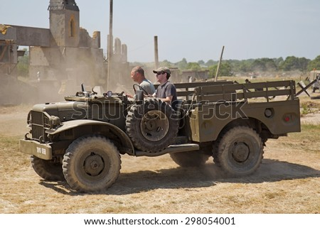 WESTERNHANGER, UK - JULY 18: An ex US army WW2 troop carrier is driven around the main arena for the public to watch at the W&P show on July 18, 2013 in Westernhanger