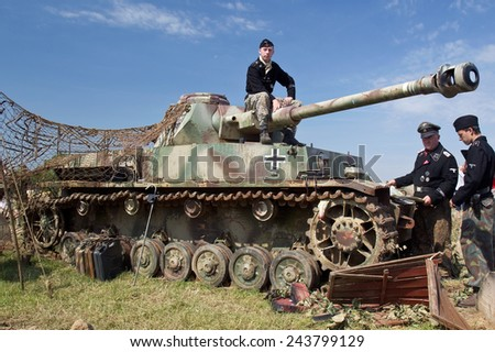 WESTERNHANGER, UK - JULY 18: German army WW2 reenactors play out a faux navigation scene for the watching public at the W&P show on July 18, 2014 in Westernhanger - stock photo